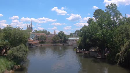 curto : Orlando, Florida. May 21, 2019. Panoramic view of Cinderella Castle and Liberty Square boardwalk from Steam Boat in Magic Kingdom.