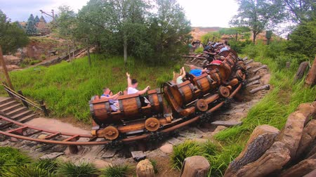 enjoynment : Orlando, Florida. May 16, 2019. People having fun Seven Dwarfs Mine Train roller coaster at Magic Kingdom (3)