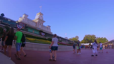 enjoynment : Orlando, Florida. May 30, 2019. People walking close to Main Street Station at Magic Kingdom. Stock Footage