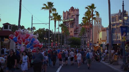 teror : Orlando, Florida. May 26, 2019. People walking on Sunset Boulevard and man selling Disney balloons at Hollywood Studios (2)
