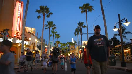 fas : Orlando, Florida. May 26, 2019. People walking on Sunset Boulevard on blue night background at Epcot.