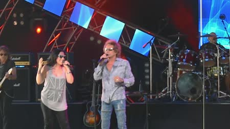 epcot : Stephanie Calvert and Mickey Thomas by Starship singing Nothings Gonna 2 Stock Footage