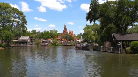 enjoynment : Orlando, Florida. May 23, 2019. Time lapse of people sailing on a raft to Tom Sawyer Island