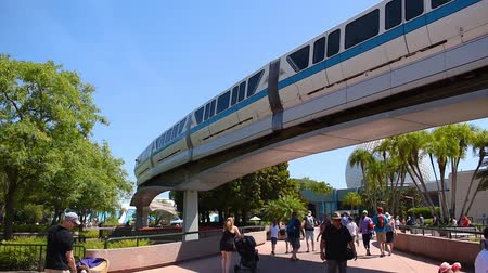 Orlando, Florida. May 24, 2019. Top view of Monorail and people walking on Future World West area in Epcot at Walt Disney World Resort area. Стоковые видеозаписи
