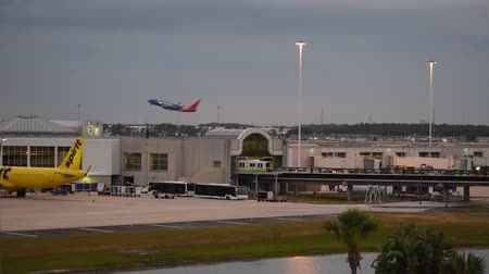 geçen : Orlando, Florida. June 03, 2019. Southwest Airlines airplane taking off on sunset at Orlando International Airport.