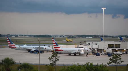 Orlando, Florida. June 03, 2019. Virgin Atlantic airplane gliding on the runway and partial view of American Airlines airplanes at Orlando International Airport.