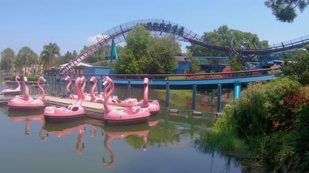 Orlando, Florida. May 25, 2019. Panoramic view of Mako rollercoaster and colorful swam boats at Seaworld
