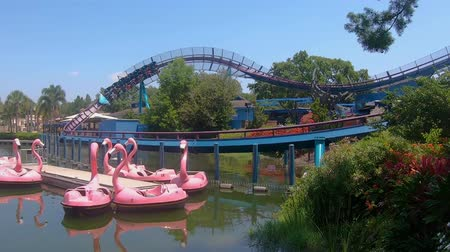 Orlando, Florida. May 27, 2019. Panoramic view of Mako rollercoaster and colorful swam boats at Seaworld Стоковые видеозаписи