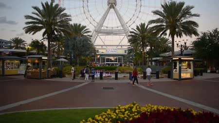 Orlando, Florida. May 23, 2019. People enjoying Icon Park area and partial view of Orlando Eye at International Drive area. Dostupné videozáznamy