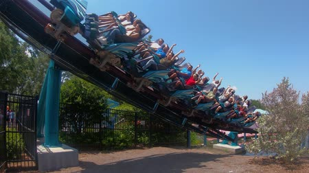 evrensel : Orlando, Florida. May 28, 2019. Terrific view in slow motion of Mako rollercoaster at Seaworld. Stok Video