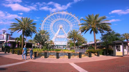 Orlando, Florida. May 25, 2019. Timelapse of Orlando Eye on cloudy lightblue sky background in International Drive area. Стоковые видеозаписи