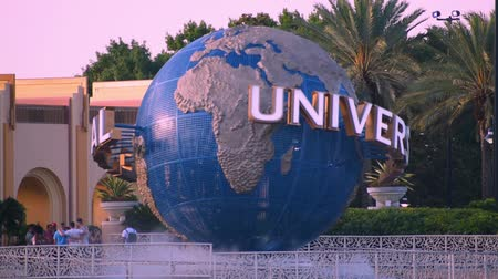 Orlando, Florida. May 22, 2019. Universal Studios world sphere at Citywalk and palm trees in Universal Studios area.