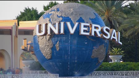 Orlando, Florida. May 21, 2019. Universal Studios world sphere at Citywalk and palm trees in Universal Studios area.