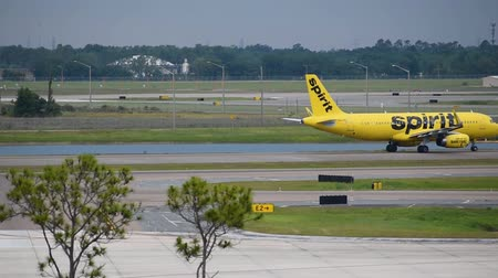 geçen : Orlando, Florida. June 03, 2019. Spirit Airlines plane on the way to take off at Orlando International Airport.
