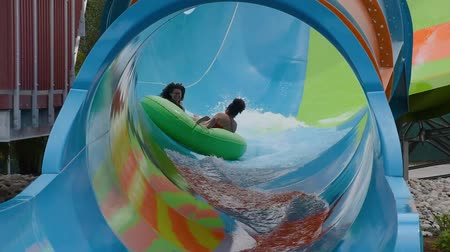 Orlando, Florida. June 05, 2019. People enjoying curve shaped wave in Karakare Curl attraction at Seaworld 2