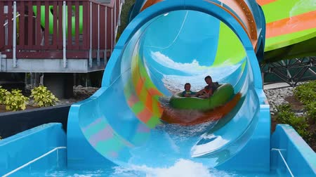 Orlando, Florida. June 05, 2019. People enjoying curve shaped wave in Karakare Curl attraction at Seaworld 5