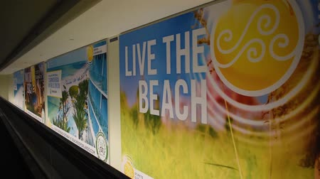 Orlando, Florida. June 03, 2019. Tourist murals promoting Clearwater and St. Pete Beach at Orlando International Airport. Стоковые видеозаписи