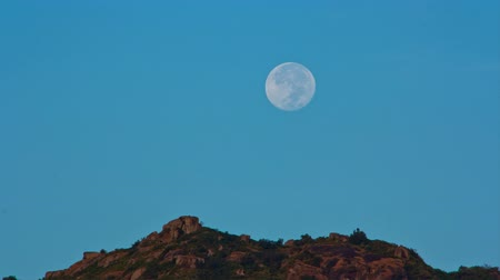 carrancudo : large moon sets over the mountain? timelapse