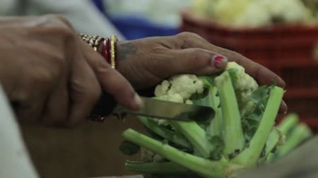 asian and indian ethnicities : Indian woman cut cauliflower
