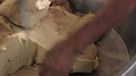 kneads : Indian woman kneads dough for chapatti