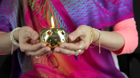 asian and indian ethnicities : Deepak candle in the hands of Indian women Stock Footage