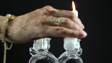 indian ethnicity : Indian woman lighting candles