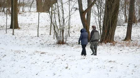strong grandma : Grandpa and woman walking in winter Park