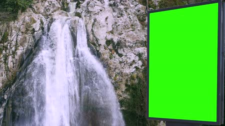 продвижение : Billboard green screen near the Fabulous waterfall