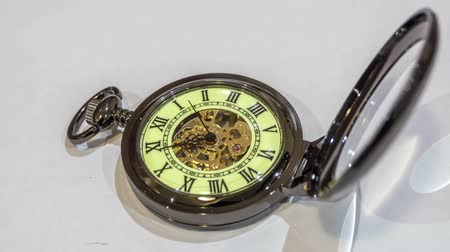 pocket watch : Pocket watch on white. timelapse Stock Footage