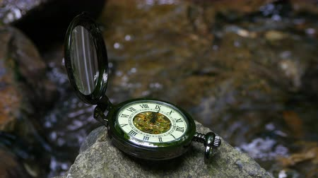 pocket watch : Pocket watch with river in background