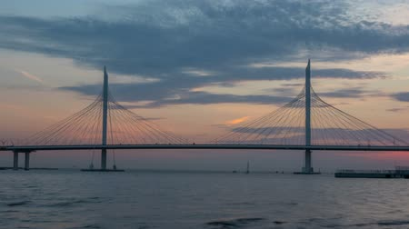 Beautiful bridge against the sunset sky. timelapse
