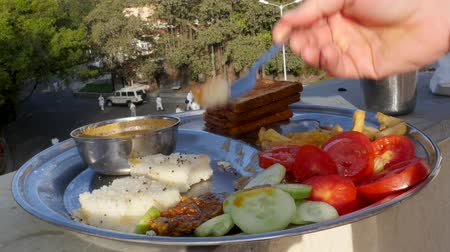 rice cake : Man eating Indian food dockla and chutney Stock Footage