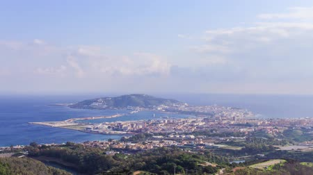ser : Timelapse of clouds flying over the city of Ceuta in Spain Stock Footage