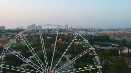 giant wheel : Superland, Rishon Lezion, Israel, June 3, 2019. Ferris wheel. A beautiful view from a drone flying near the observation wheel against the backdrop of a beautiful amusement park.