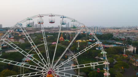карусель : Superland, Rishon Lezion, Israel, June 3, 2019. Ferris wheel. A beautiful view from a drone flying near the observation wheel against the backdrop of a beautiful amusement park.