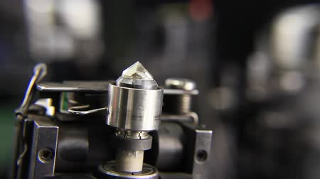 cutting up : Production and manufacturing the DIAMOND and mastered brilliants. Technological processes of manufacturing, cutting, grading, polishing and faceting the DIAMOND. In the hands of masters, the rough diamonds begin the final step in their journey to realize  Stock Footage