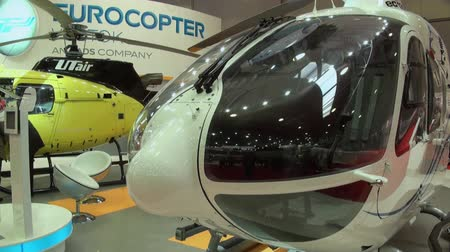 krokus : RUSSIA, MOSCOW - 21 MAY 2012: Manufacturers stands and modern model helicopters. Exhibition of helicopter military  transport industry in Crocus Expo. Manufacturers stands, interiors and modern model.