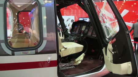krokus : RUSSIA, MOSCOW - 21 MAY 2012: View and interior executive VIP helicopter. Exhibition of helicopter military  transport industry in Crocus Expo. Manufacturers stands, interiors and modern model.