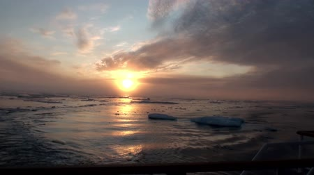 disko : Sunset in the ocean among the icebergs and ice in the Arctic. Fantastic wonderful amazing video grenland nature iceland. Lovely shooting the life of nature, seaside and mountains. Global warming.