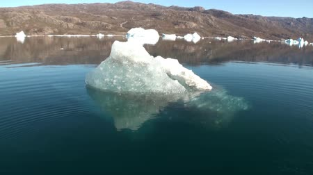 disko : Small Iicebergs floating in sea around Greenland in Arctic,. Fantastic wonderful amazing video grenland nature iceland. Lovely shooting the life of nature, seaside and mountains. Global warming.