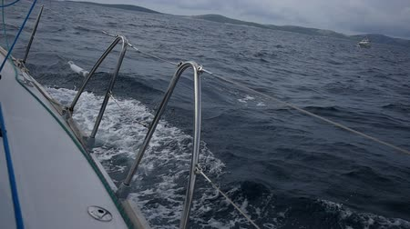 lanoví : Aboard and handrails yacht on a background of sea waves in Greece. Regatta. Adventures in the ocean. Slow motion.