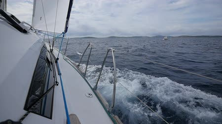 lanoví : Aboard of yacht on background of sea waves in Greece. Regatta. Adventures in the ocean. Slow motion.
