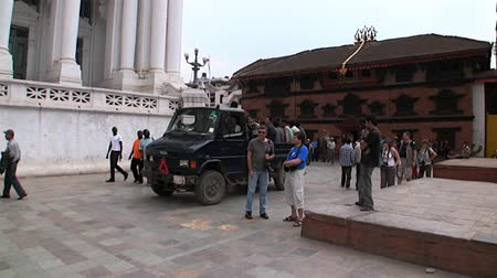 patan : Kathmandu, Nepal - 17 October 2011: Cargo car rides on a background of locals and tourists. Durbar Square and its surroundings. Stock Footage