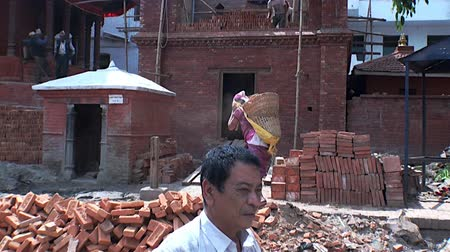 patan : Kathmandu, Nepal - 17 October 2011: Work wears bricks in Durbar Square and its surroundings. Stock Footage