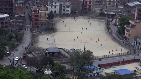 patan : Kathmandu, Nepal - 17 October 2011: Men are playing football on streets.