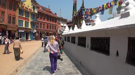 chant : Kathmandu, Nepal - 17 October 2011: Calm people walk on streets of Durbar Square and its surroundings.
