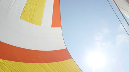 lanoví : Colorful sail on background of sky. Regatta. Adventures in the ocean. Slow motion.