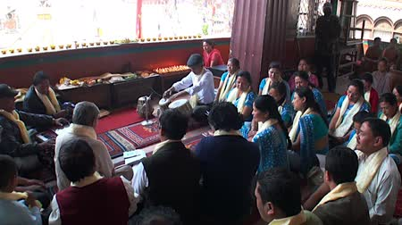 patan : Kathmandu, Nepal - 17 October 2011: Believers sing prayers in the temple. Stock Footage