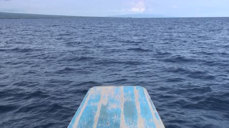 Строки : Bow of boat on water surface on background of sky in sea Philippines. Travel in world of unique colorful beautiful ecosystem of nature.