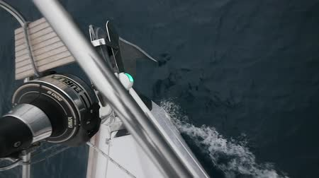 lanoví : Deck yacht top view on background of sea waves in Greece. Regatta. Adventures in the ocean. Slow motion.